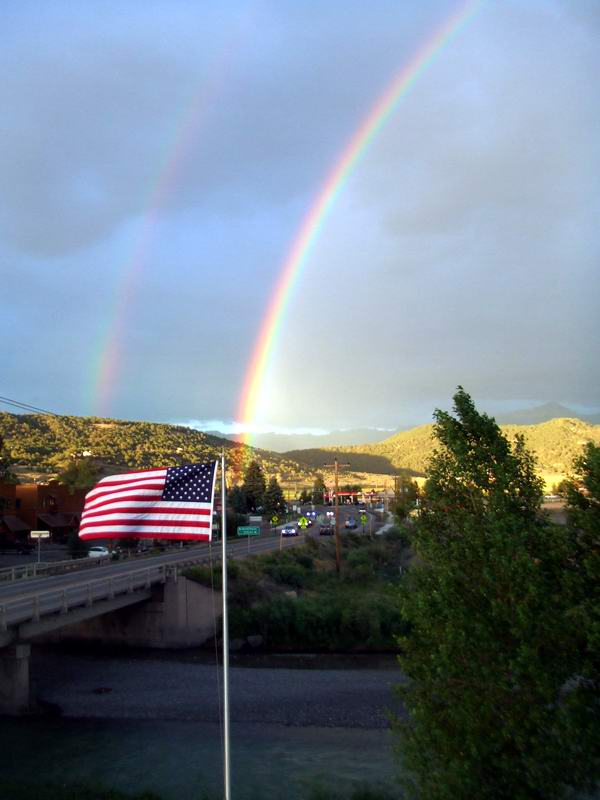 Rainbow ends at the American Flag.