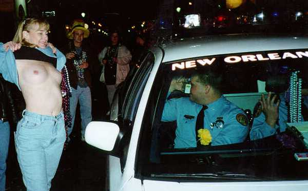 A New Orleans police officer demonstrates how he will gather evidence of any law-breaking behavior.