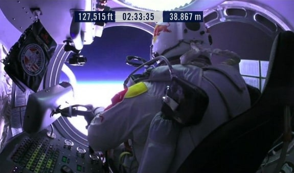 Baumgartner opens the door of his capsule, getting ready to climb out.