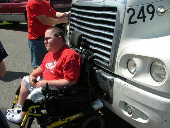 Ben Carpenter sits in his chair, waiting for it to be pried out of the truck's grille.